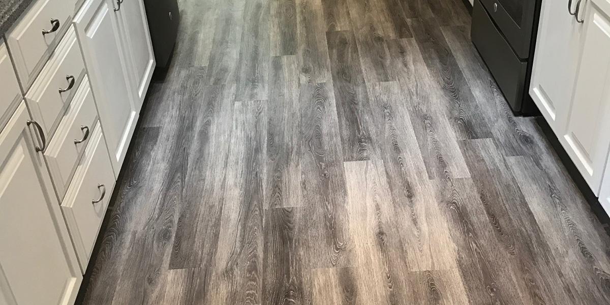grey vinyl plank in galley kitchen
